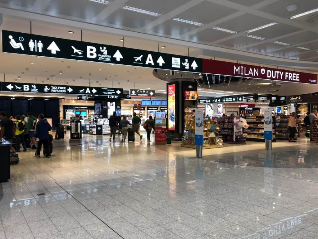 Airport Milan Malpensa with Signs and a Duty Free
