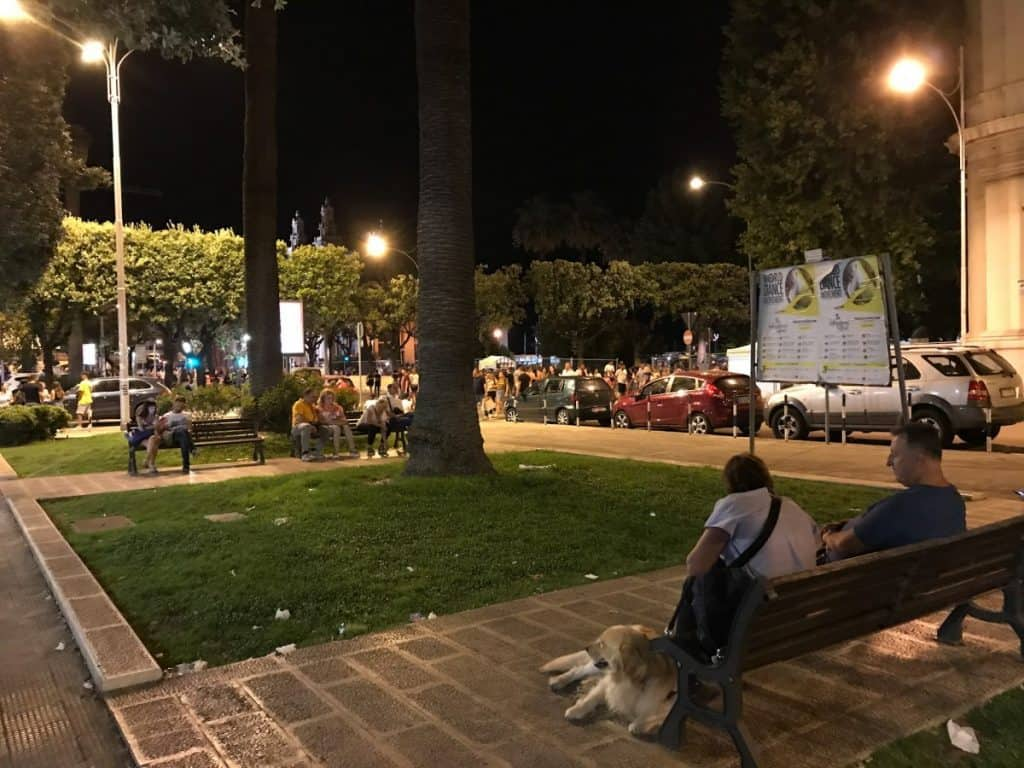 People sitting on a Bench at Night in Bari