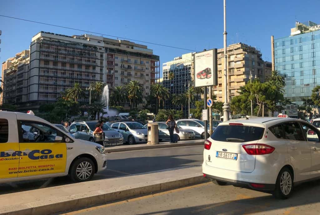Italian white taxis wating in front of the train station