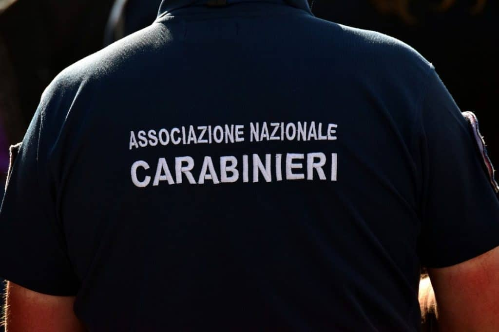Back of a carabinieri wearing a shirt with a text