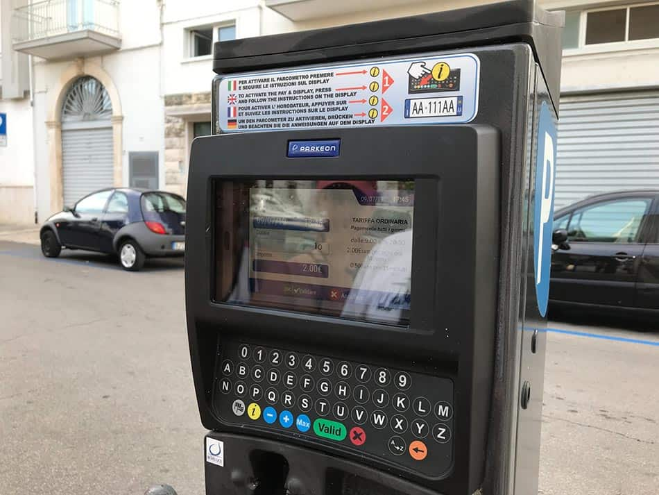 """Black parking meter with a blue """"P"""" on the side and a display"""