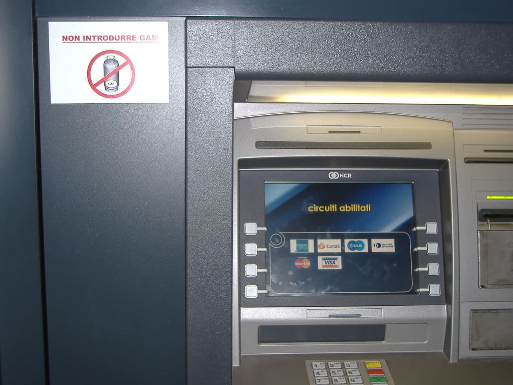 ATM blue machine with a white sign on the left