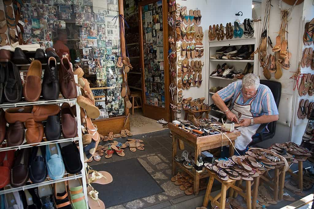An Italian Cordwainer making shoes in his workshop