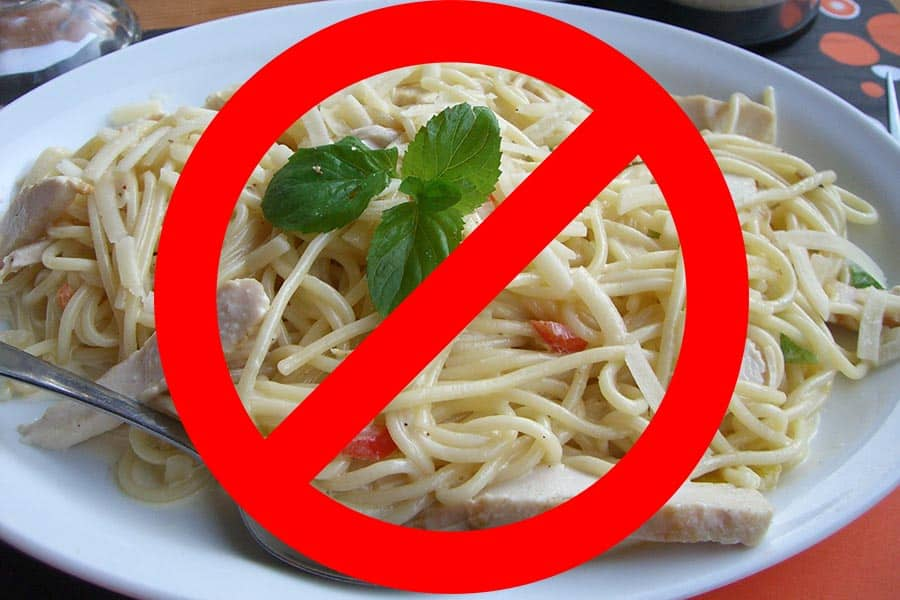 Plate of spaghetti with mint and a forbidden symbol