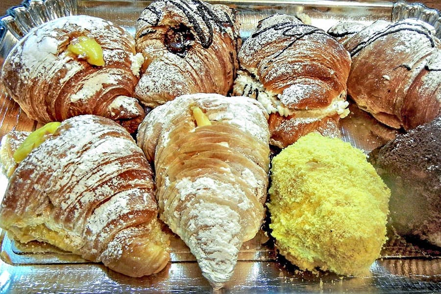 Croissants with powdered sugar and cream